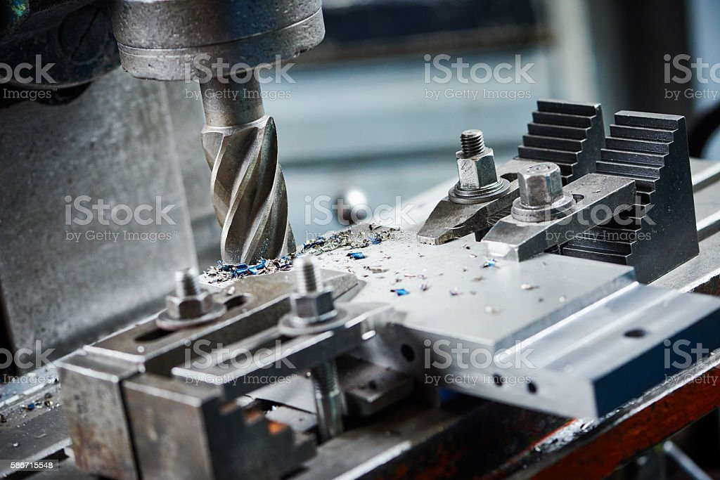 industrial metalworking cutting process by milling cutter stock photo