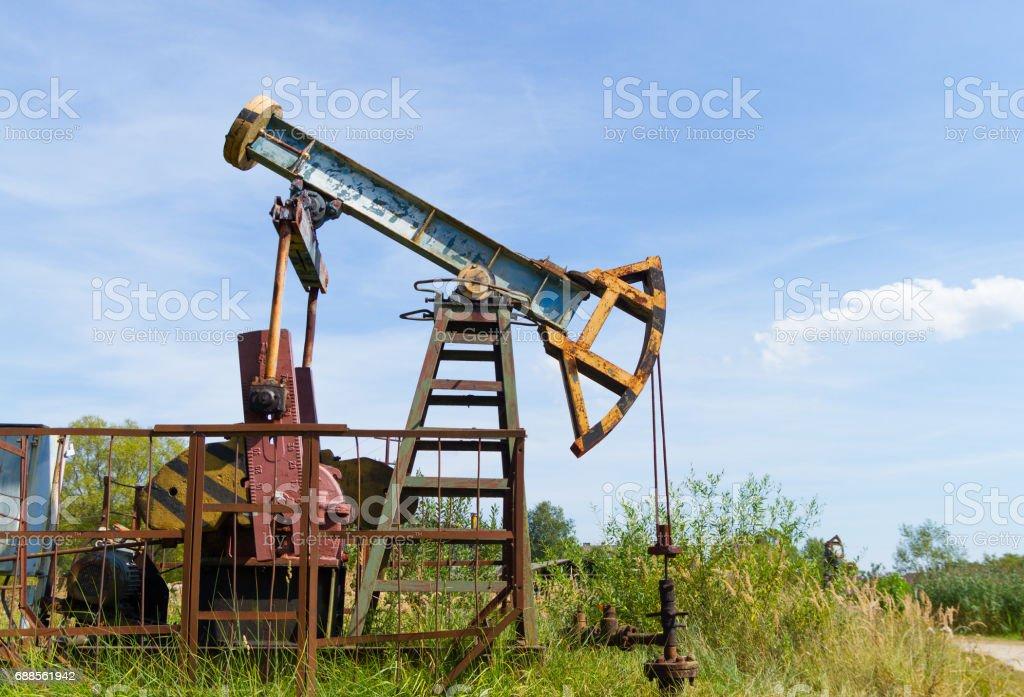 Industrial oil pump jack stock photo