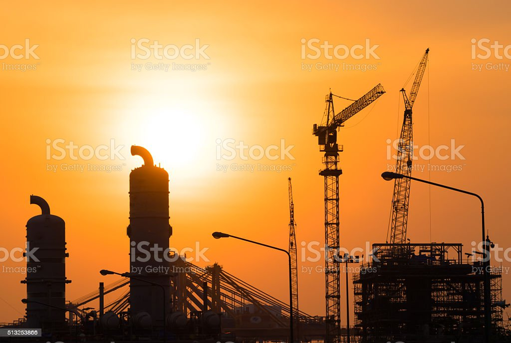 Industrial Oil refinery in building on sunset background stock photo