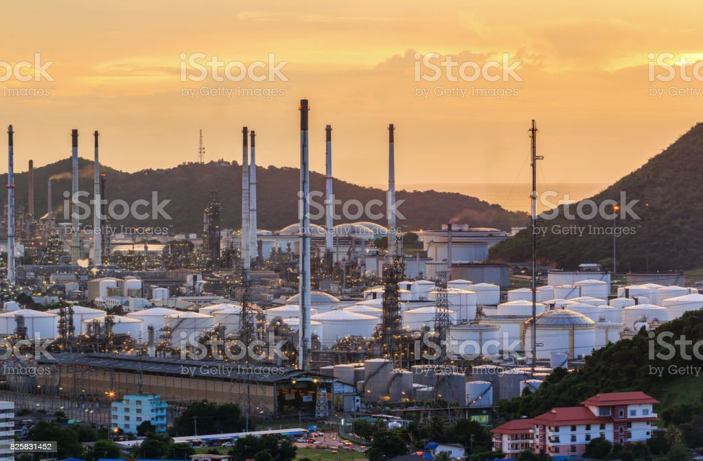 Industrial oil tanks and oil refinery plant with twilight stock photo