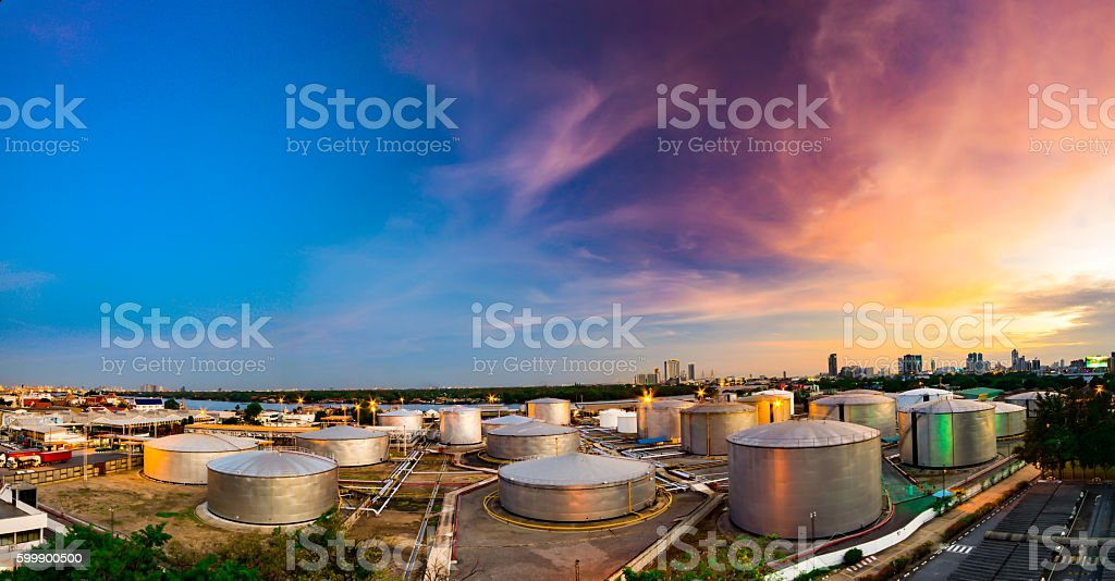 Industrial oil tanks in a refinery at twilight stock photo