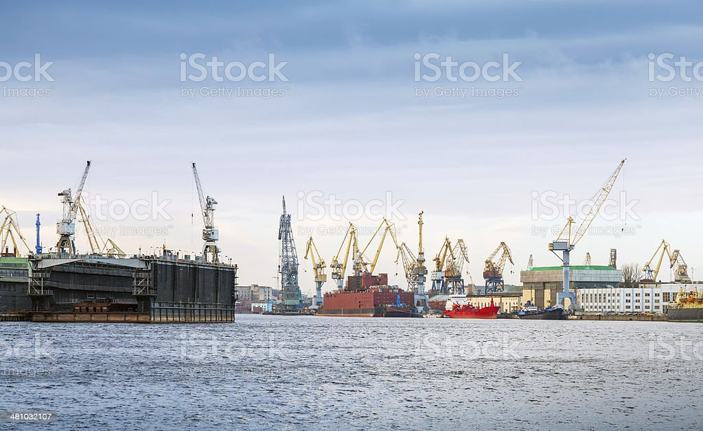 Industrial panorama with cranes and docks. Big Neva River royalty-free stock photo