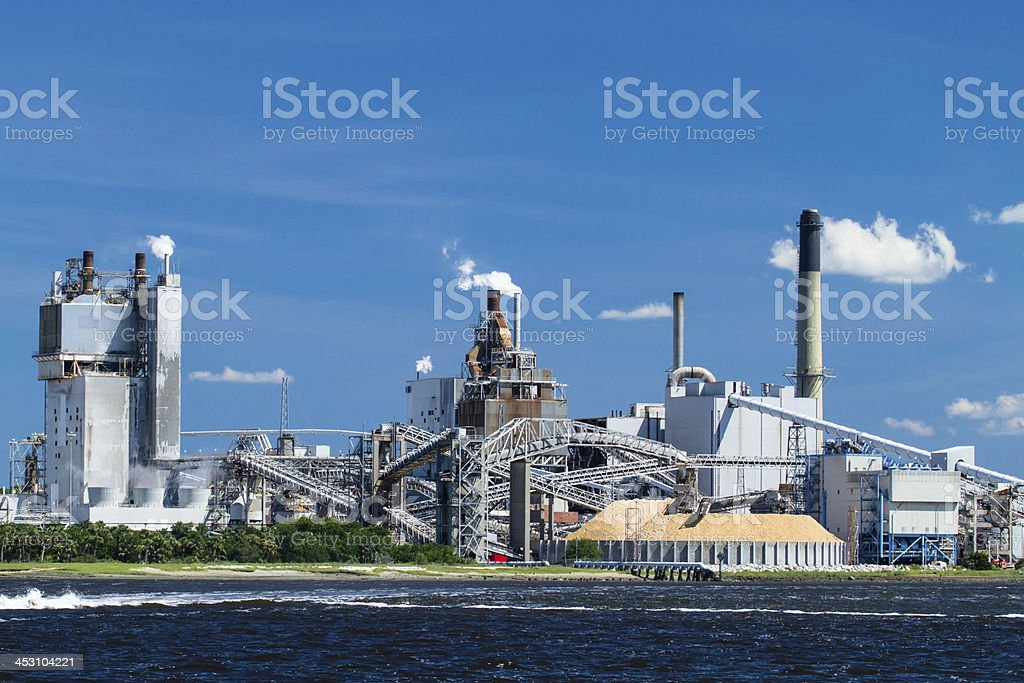 Industrial Paper Mill on a River stock photo