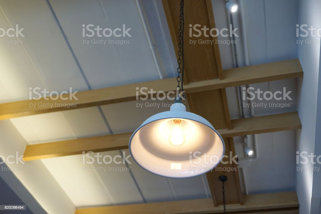 Industrial pendent lamp with white metal shade hanging stock photo