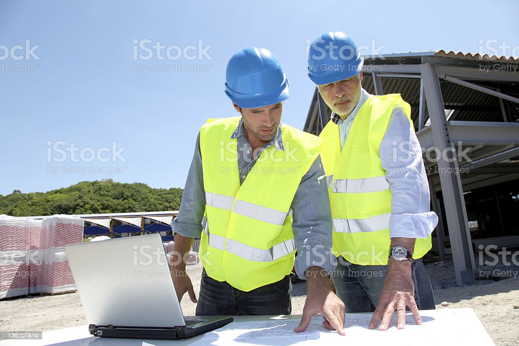 Industrial people working on building site royalty-free stock photo