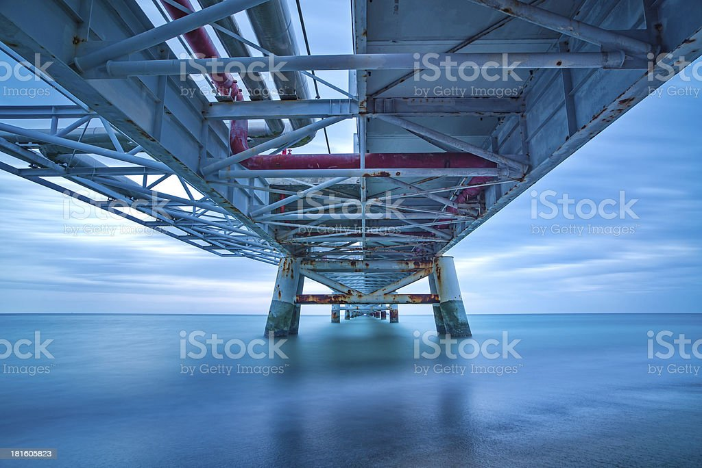 Industrial pier on the sea. Bottom view. Long exposure photography. royalty-free stock photo