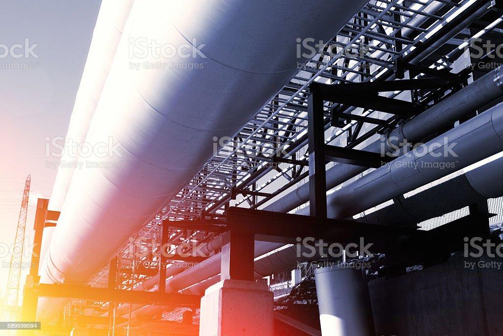industrial pipelines on pipe-bridge against blue sky stock photo