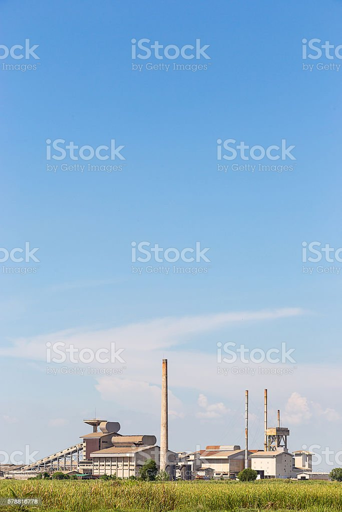 industrial plant behind the meadow stock photo
