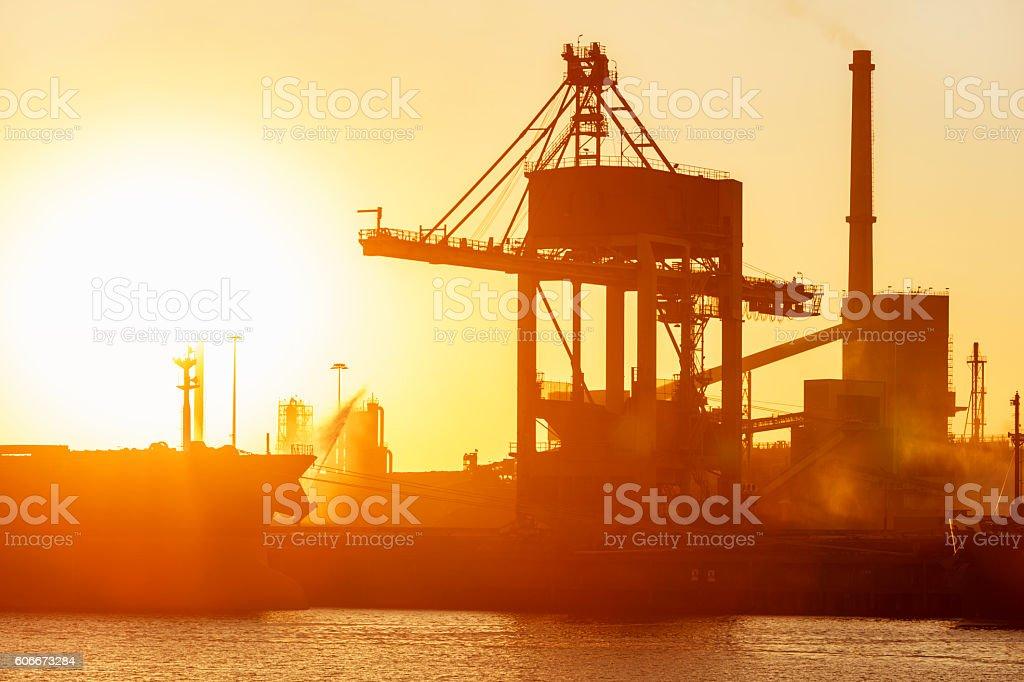 Industrial Plant, Crane and Ship in Sunset Light, Amsterdam, Netherlands stock photo