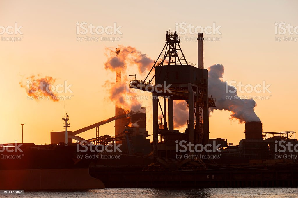 Industrial Plant, Crane and Ship in Sunset Light stock photo