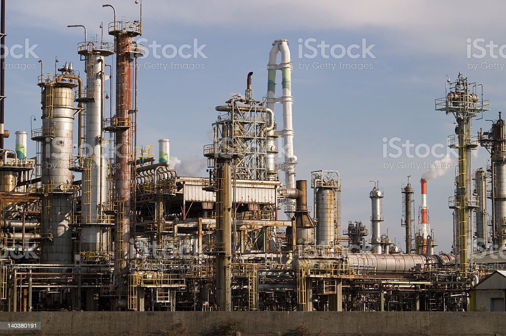 Industrial plant with cloudy sky background royalty-free stock photo