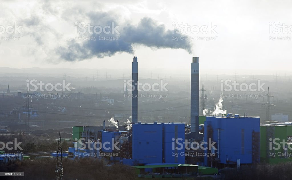 Industrial Plant with smoking Chimneys royalty-free stock photo