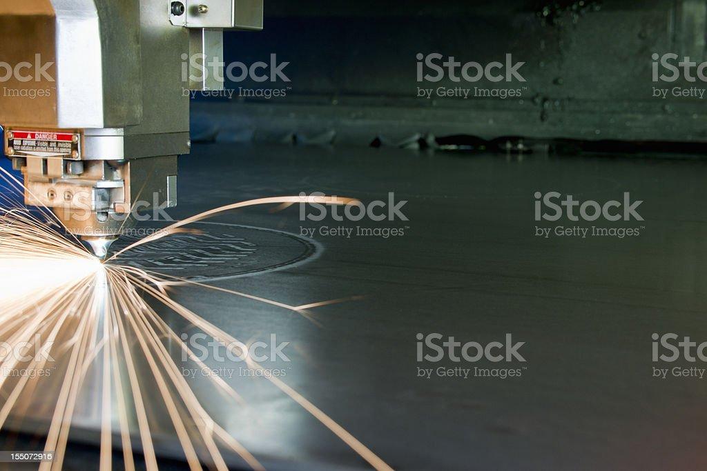 Industrial, plasma metal-cutting tool in operation. stock photo