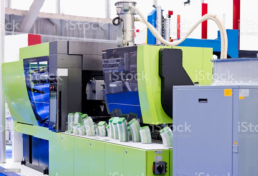 Industrial plastic injection moulding machine stock photo