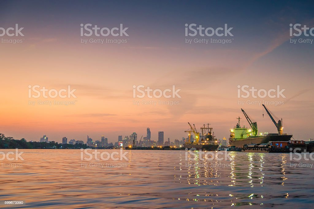 Industrial port and Container ship logistic the harbor in Asia , stock photo