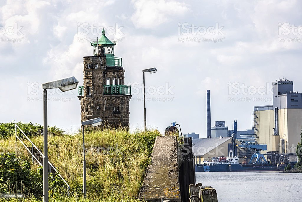 Industrial port with lighthouse in Bremen stock photo