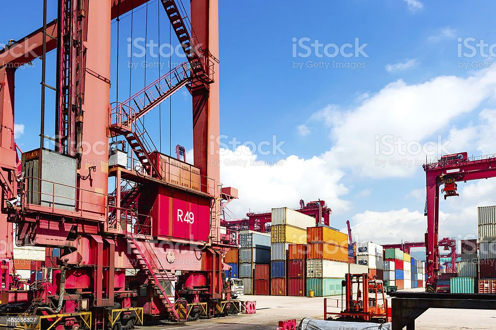 Industrial port with machinery and cargo containers royalty-free stock photo