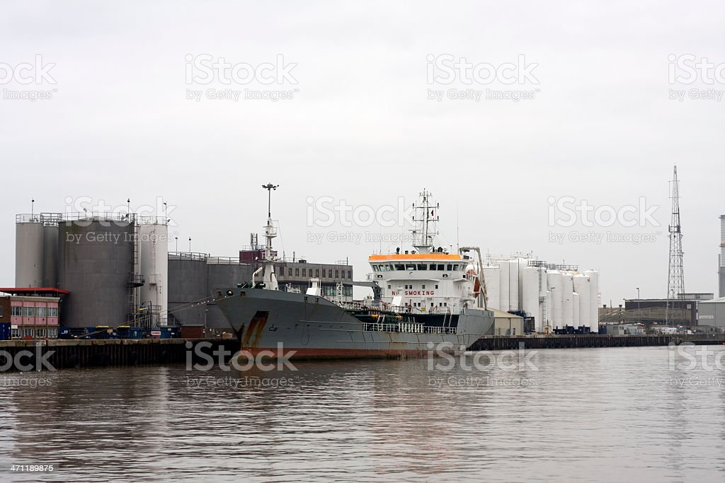 Industrial port with ship docked royalty-free stock photo