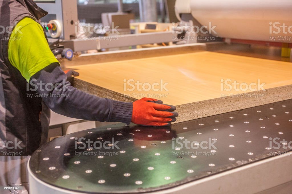 Industrial processing of board materials stock photo