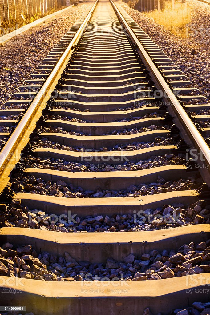 Industrial railway track at dusk stock photo