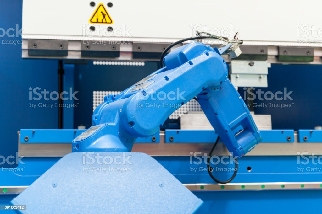 Industrial robotic arm. Assembly, machine tending, part transfer, pick and place robot. stock photo