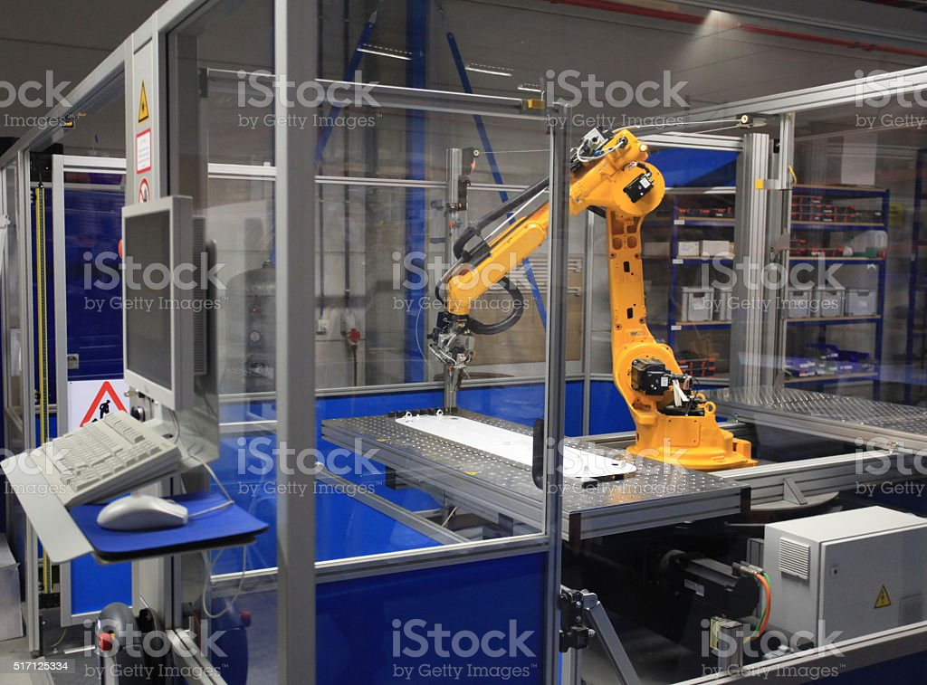 Industrial robotic arm in a factory stock photo