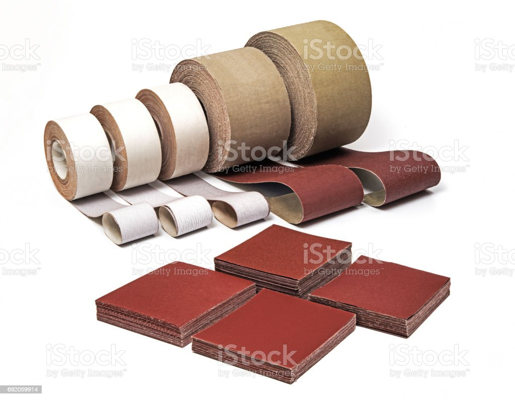 Industrial Sanding Belts, Sand Papers in Rolls and Sandpaper Sheets stock photo