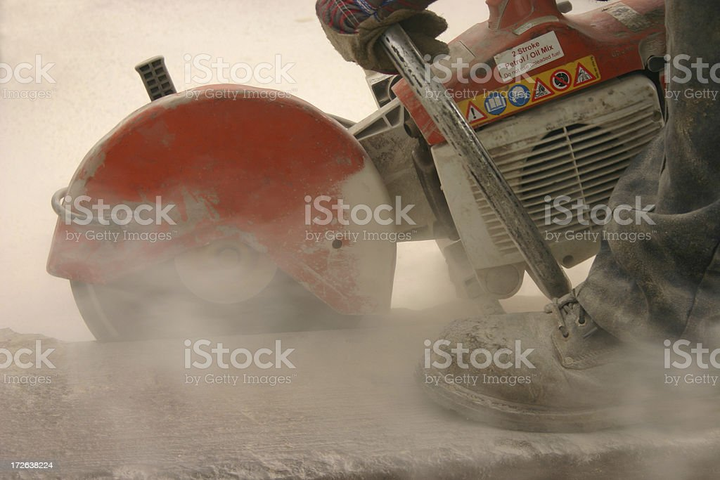 industrial saw cutting a kerb royalty-free stock photo