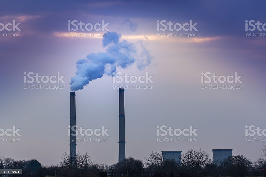 Industrial scenery with smoke from coal powered plant stock photo