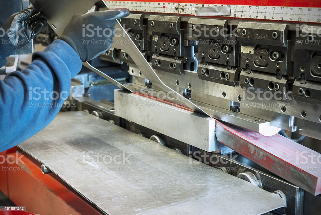 Industrial sheet metal brake press in operation royalty-free stock photo