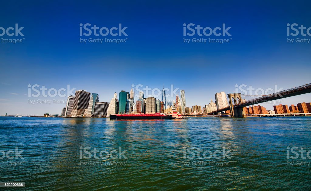 Industrial Ship Passing Downtown Manhattan on East River, New York stock photo