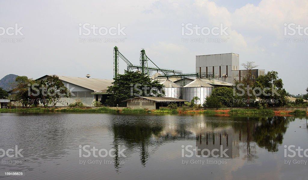 industrial, silo near pond. royalty-free stock photo