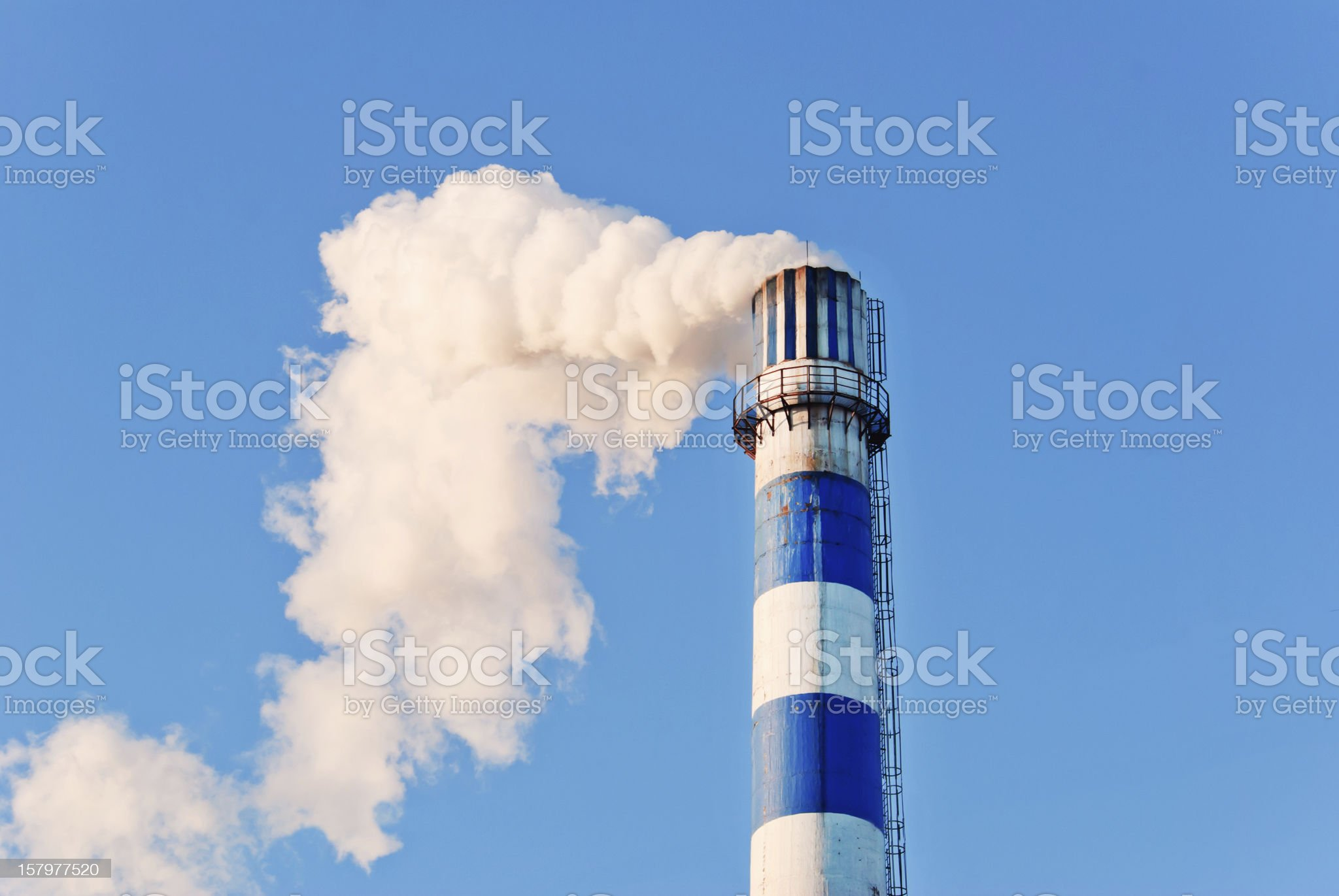industrial smoke from chimney on blue sky royalty-free stock photo