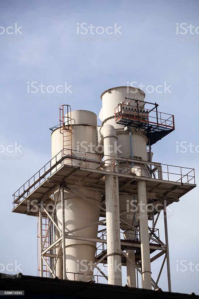Industrial smoke from chimney on blue sky stock photo