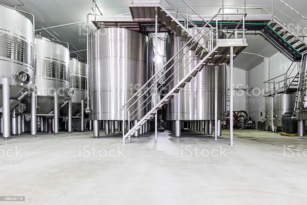 Industrial stainless steel wine cellar vats stock photo