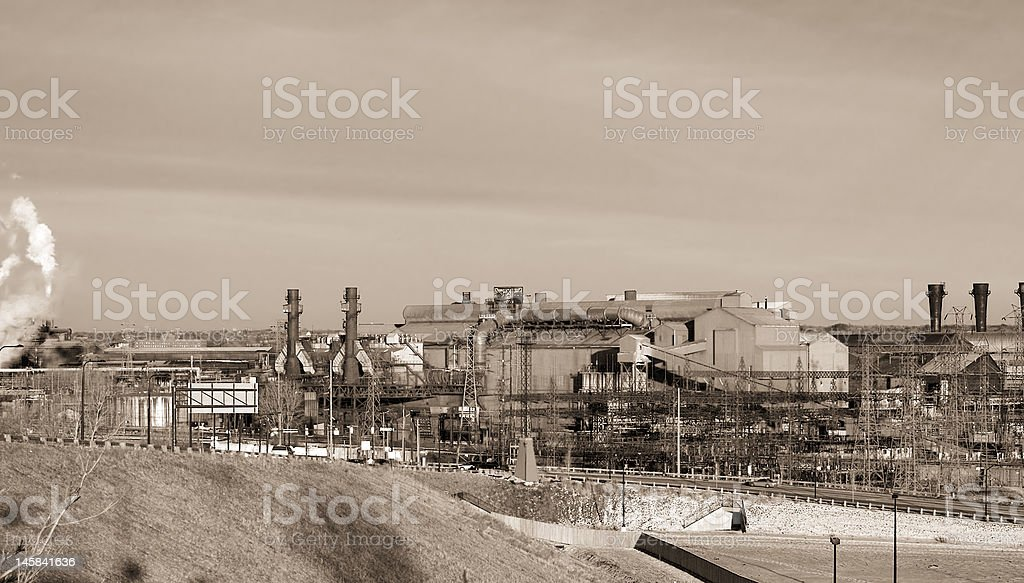 Industrial steel mill in sepia royalty-free stock photo