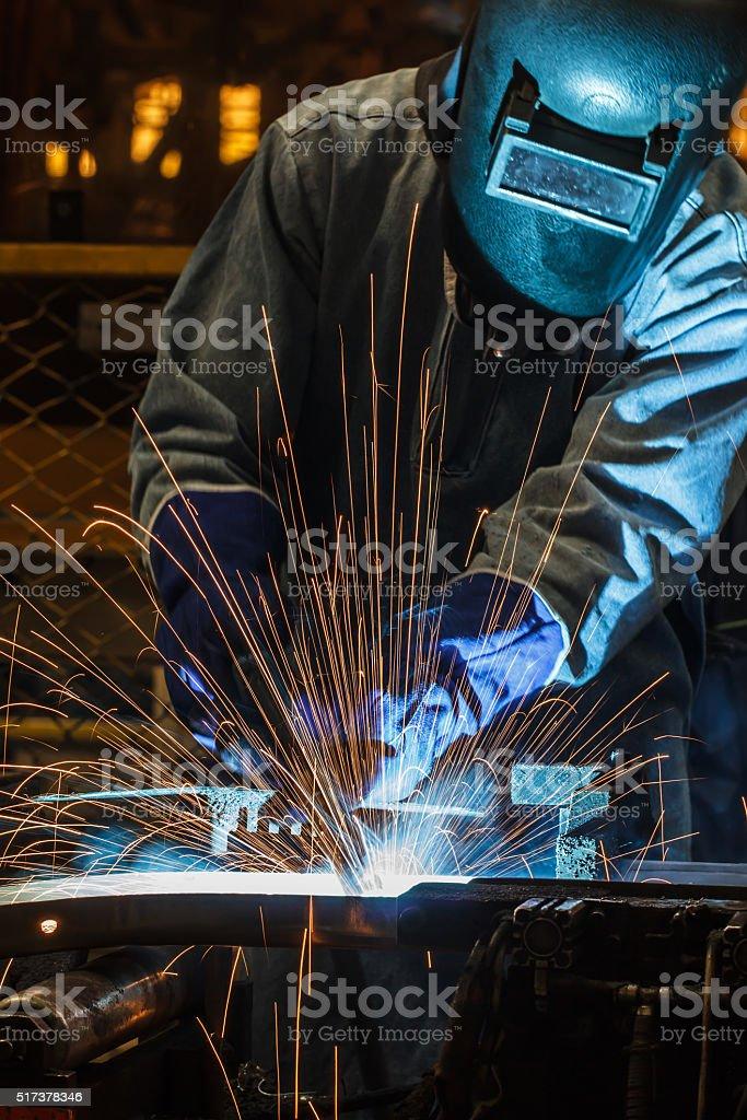 Industrial steel welder in factory stock photo
