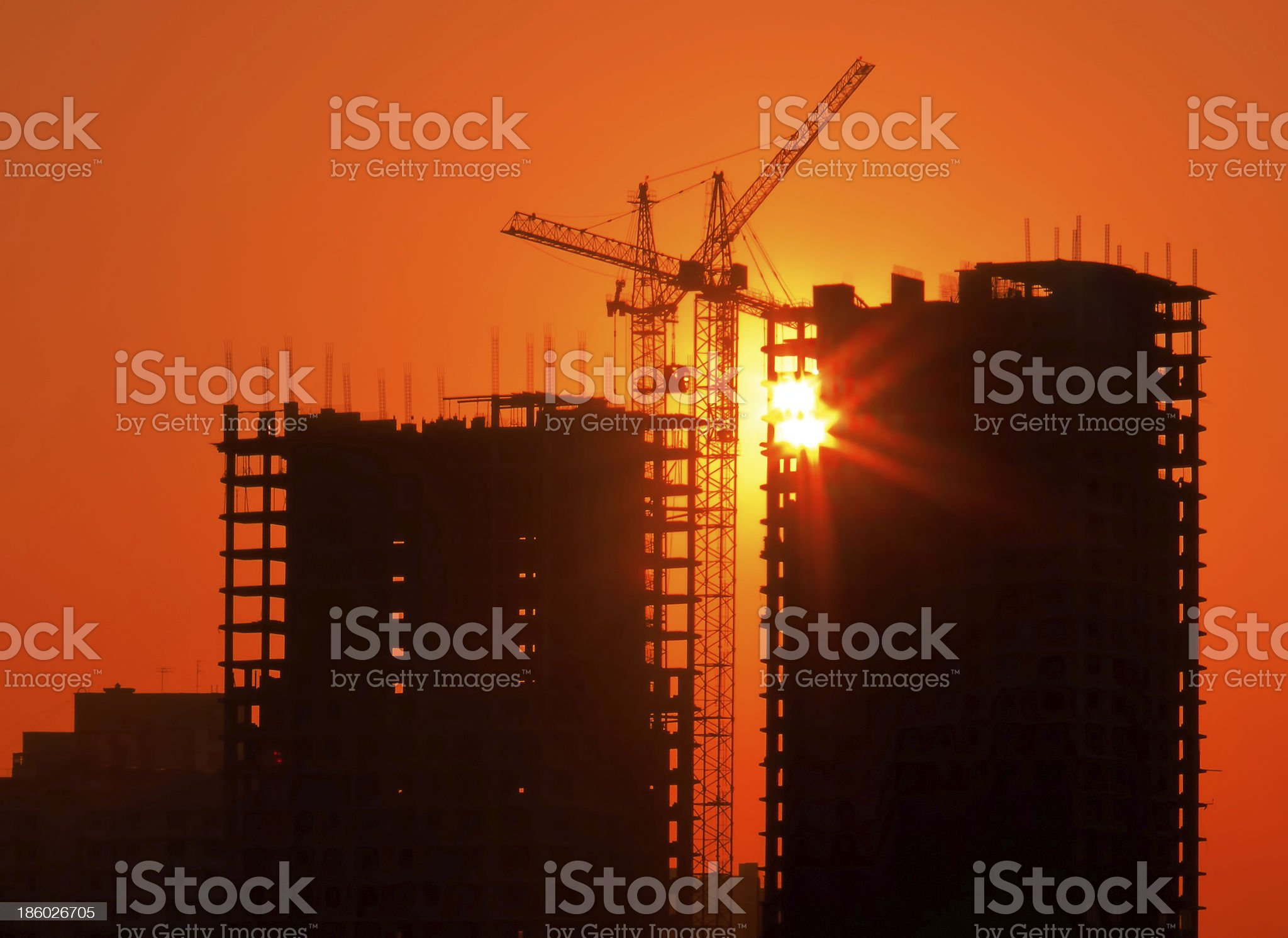 Industrial sunset with cranes royalty-free stock photo