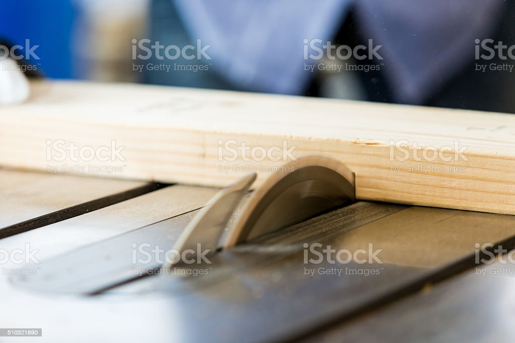 Industrial table saw cutting boards in workshop stock photo