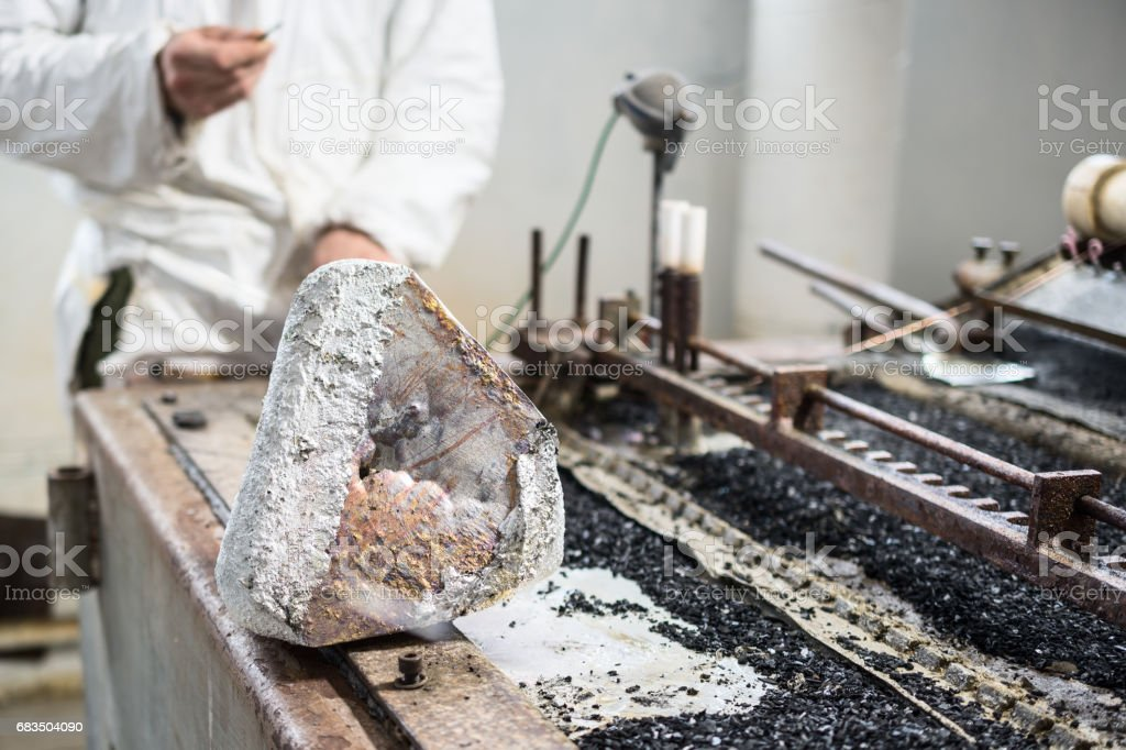 Industrial tinning of wire. Bath with molten solder stock photo