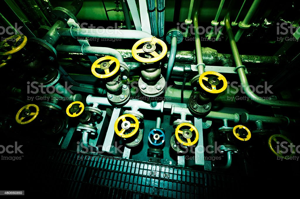 Industrial Valves aboard a ship stock photo