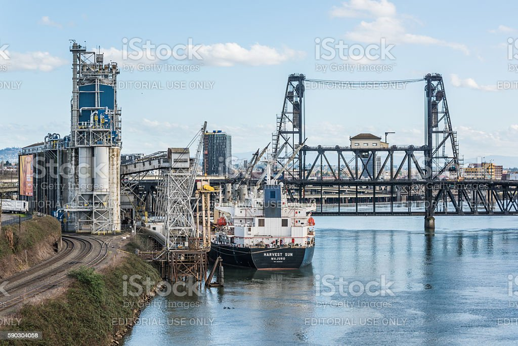 Industrial view in Oregon with ship, cranes, factory and railroad stock photo