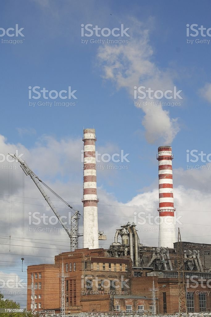Industrial view with smoking factory tubes royalty-free stock photo