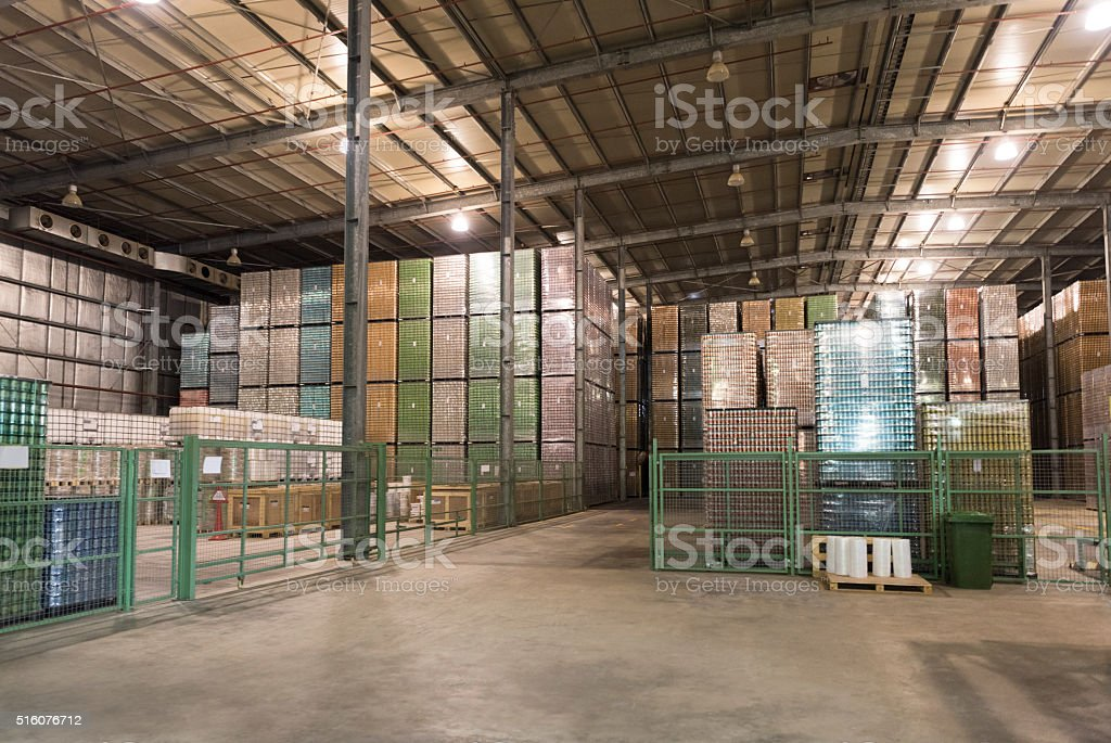 Industrial warehouse with stacked containers stock photo