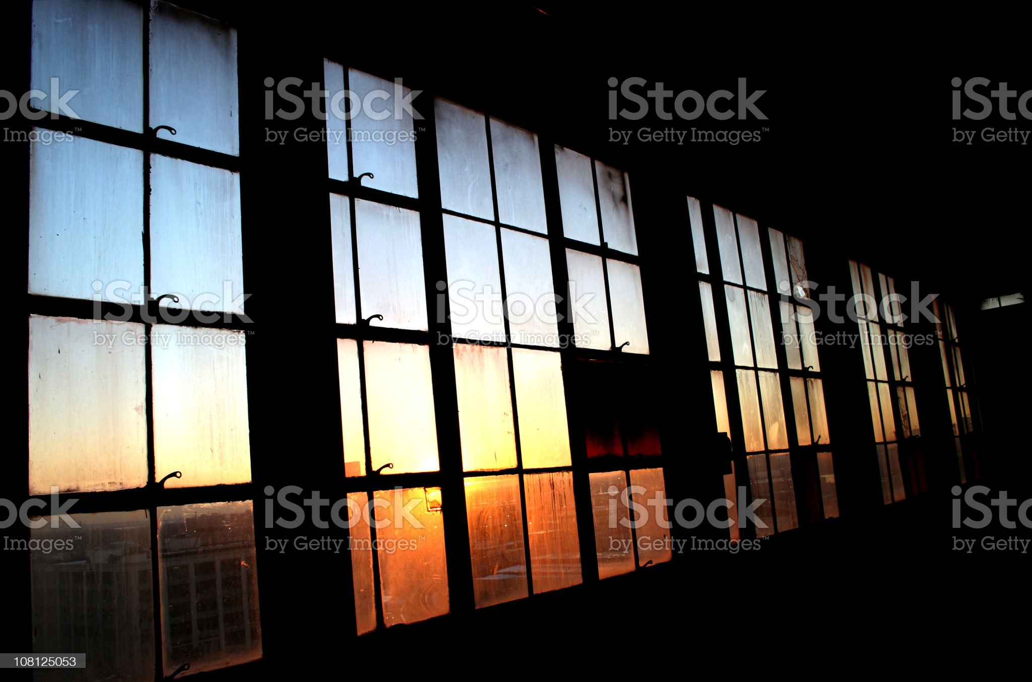 Industrial Window Pane with Sunset Shining Through royalty-free stock photo