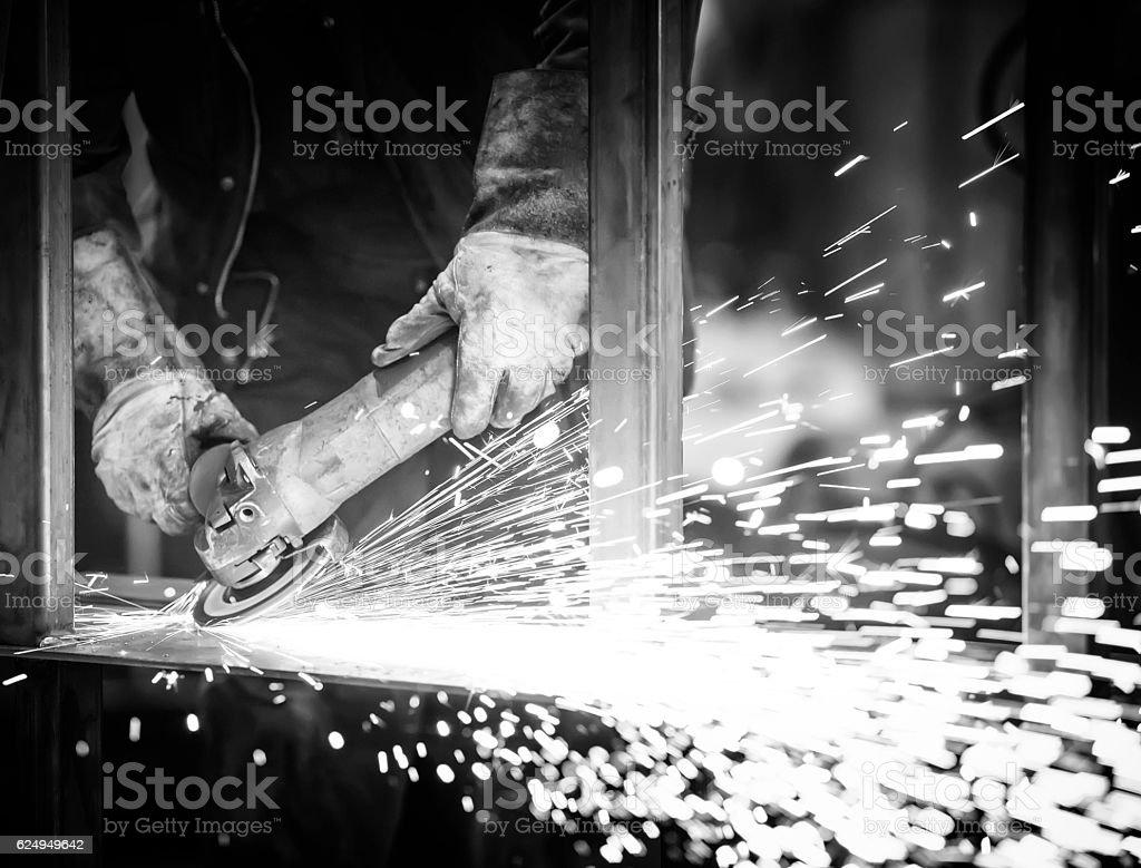 industrial worker grinding steel in workshop stock photo