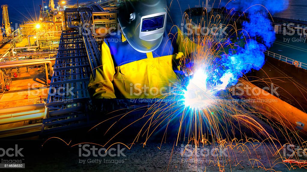 Industrial Worker in action welding close up stock photo