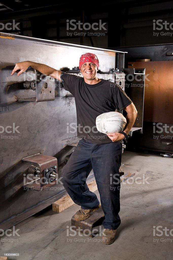Industrial worker standing in factory stock photo