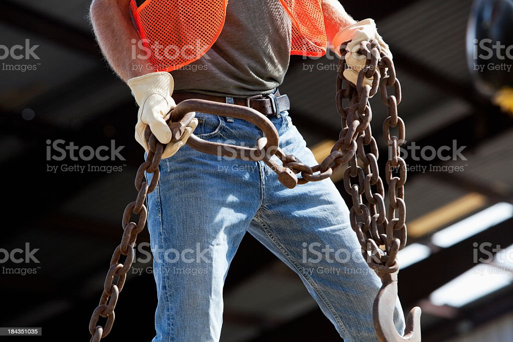 Industrial worker with hook and chain stock photo