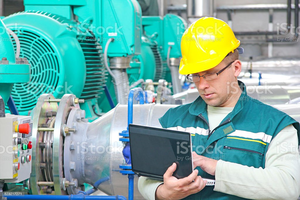 Industrial worker with notebook stock photo